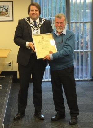 Town Mayor Peter Hudson presents Phil Folly with his Freeman status